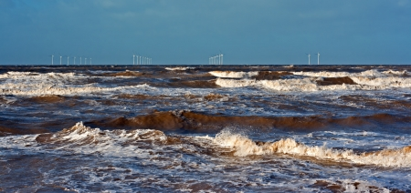 Offshore wind farm on a stormy day photo