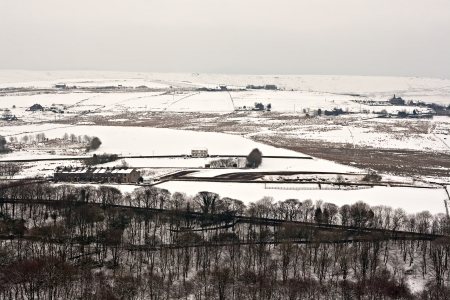 moors: Remote farmland on the snow covered Yorkshire moors