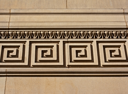 architectural styles: Intricate mouldings on old sandstone building Stock Photo