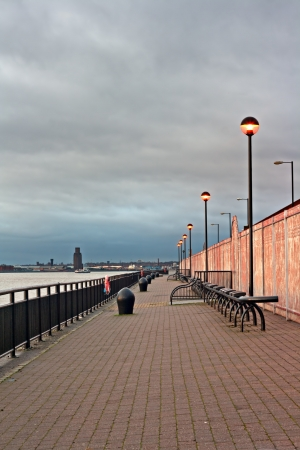 mersey: Promenade on the River Mersey, Liverpool, UK, with ferry crossing the river at sunset