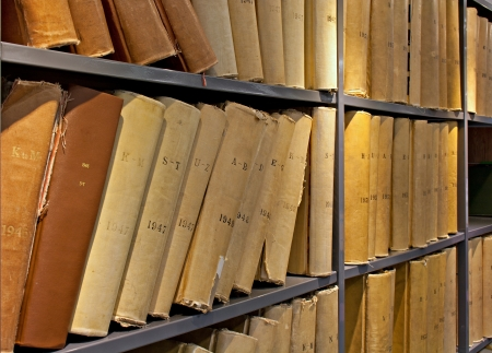 Old volume of library books on shelving