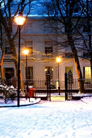 nightime: Georgian houses in traditional winter snow scene at nightime