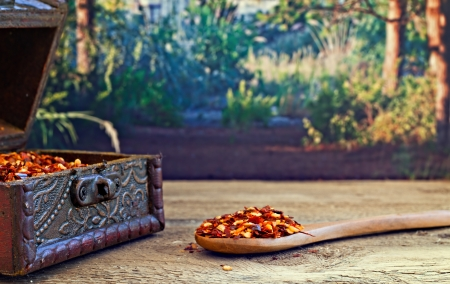 mediteranean: Dried red chilli flakes on rustic wooden table