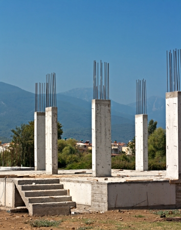 reinforced: Reinforced concrete pillars on house under construction