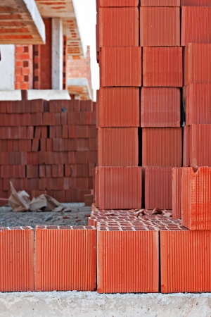 redbrick: Stack of red building blocks on a construction site