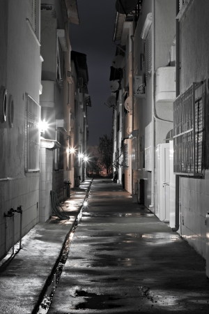 Dark empty back alleyway after the rain photo