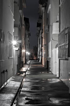 Dark empty back alleyway after the rain photo