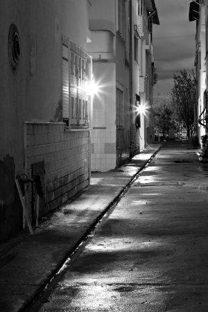 nightime: Dark empty back alleyway after the rain