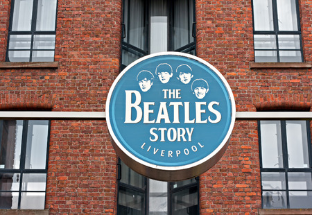 The Beatles Story Exhibition Sign, at Albert Dock, Liverpool, UK. A popular tourist attraction.