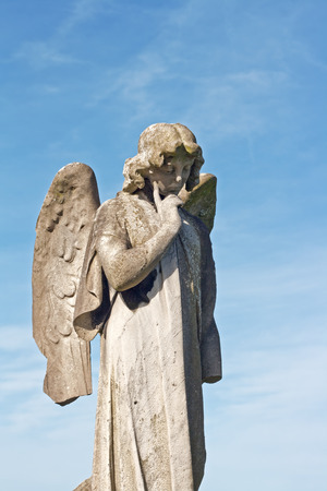 angel cemetery: Winged angel statue in ancient graveyard Stock Photo