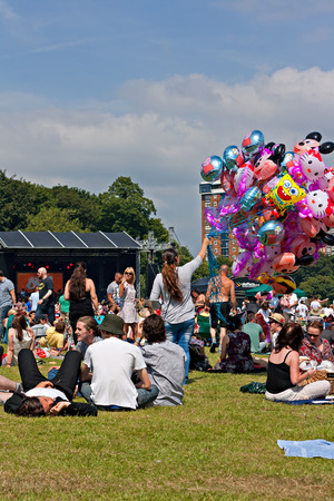 SEFTON PARK, LIVERPOOL, UK JUNE 6, 2014. Crowd enjoying the annual African Oye music festival in Sefton Park, Liverpool UK Editorial