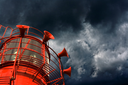 approaching: Red lightship with fog horns against storm clouds
