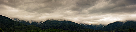 Low clouds over the mountains photo