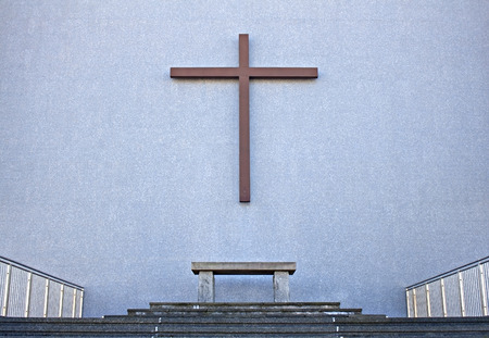 crucifiction: Cross with bench on exterior wall  of Cathedral