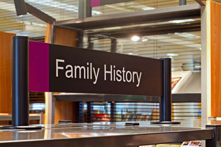 family history: Family History section sign inside a modern public library Stock Photo