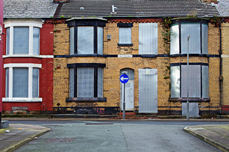 urban redevelopment: A street of boarded up derelict houses awaiting regemeration in Liverpool UK