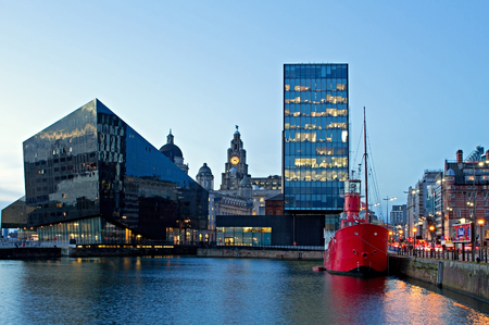 The Albert Dock and Liver Buildings in Liverpool UK at dusk Editorial