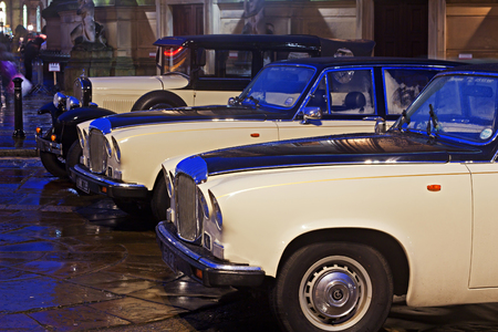 daimler: LIVERPOOL 16TH JANUARY 2016. Classic Daimler and Model T Ford wedding cars outside St Georges Hall.