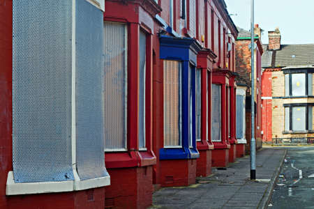 urban redevelopment: A street of boarded up derelict houses awaiting regeneration in Liverpool UK
