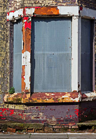 abandoning: A street of boarded up derelict houses awaiting regeneration in Liverpool UK