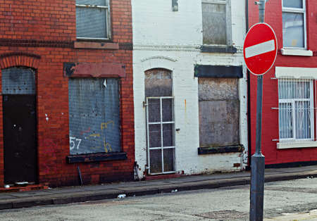 regeneration: A street of boarded up derelict houses awaiting regeneration in Liverpool UK