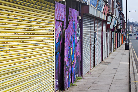 refurbished: LIVERPOOL UK 3RD APRIL 2016 A street of derelict shops being sold by the council for £1 each to be refurbished