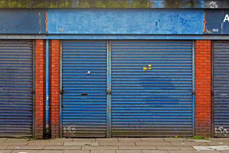 urban redevelopment: LIVERPOOL UK 3RD APRIL 2016 A street of derelict shops being sold by the council for ?1 each to be refurbished