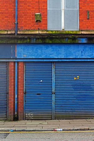 urban redevelopment: LIVERPOOL UK 3RD APRIL 2016 A street of derelict shops being sold by the council for £1 each to be refurbished