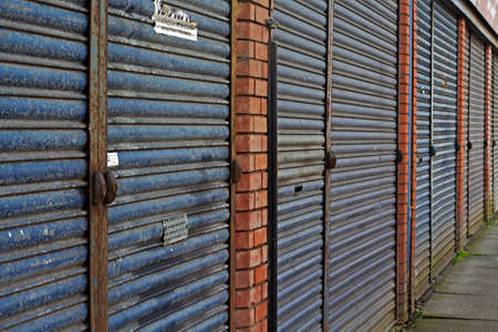 abandoning: LIVERPOOL UK 3RD APRIL 2016 A street of derelict shops being sold by the council for �1 each to be refurbished