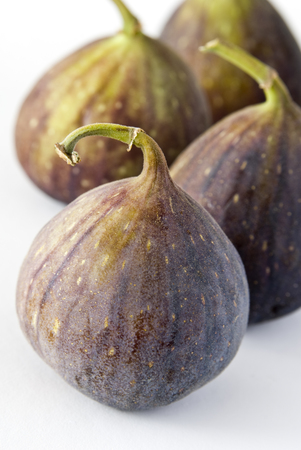 Four fig fruits on a white background. 版權商用圖片