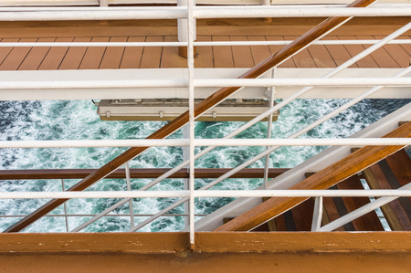 Detail of exterior access stairway and deck, stern of cruise ship.