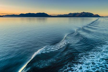 Beautiful morning light and water ripples from ships wake, Alaska, USA.