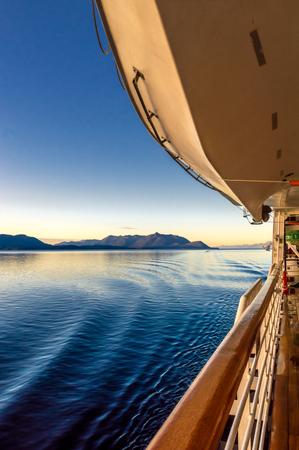 Beautiful morning light and cruise ships Starboard wave ripples, Alaska, USA.