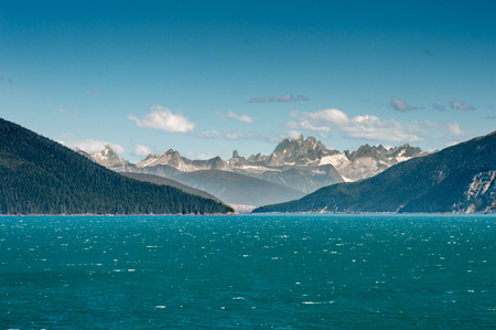 Entrance to teal colored glacial waters of windy Taku Inlet, Juneau, Alaska, USA