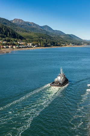 Local tugboat heading North, Gastineau Channel, Juneau, Alaska, USA.