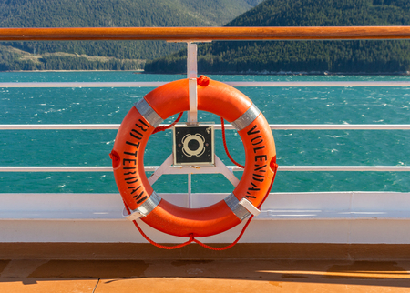 September 14, 2018 - Inside Passage, Alaska: Bright orange lifering life saving equipment stored on railing of The Volendam cruise ship.