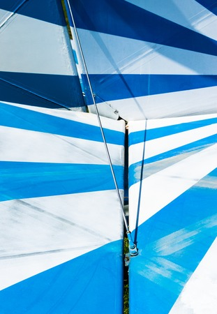 Striped blue and white paint pattern on a vintage small aircraft.