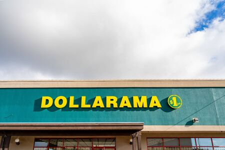 Surrey, Canada - Feb 3, 2020: Front of Dollarama chain store with cloudy sky