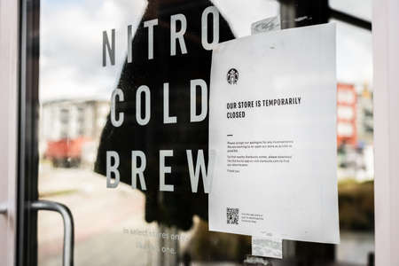 Surrey, Canada - Mar 25, 2020: Starbucks shop closure notice during Coronavirus