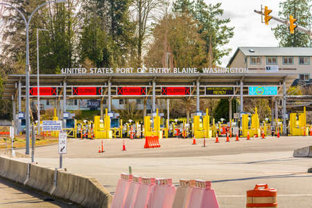 Surrey, Canada - Mar 29, 2020: Empty car lanes at Pacific Border Crossing USA entrance during Covid-19 Coronavirus shutdown, normally one of the busiest border crossings between the USA and Canada