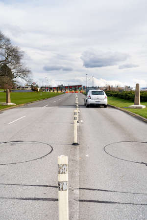 Surrey, Canada - Mar 29, 2020: Empty car lanes on approach to closed USA border station during Cronovirus Covid-19 pandemic