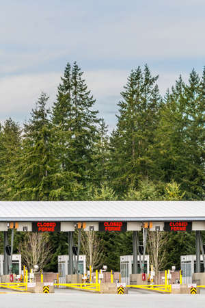 Surrey, Canada - March 29, 2020: Empty inspection stations at closed Peace Arch Canadian border entrance during Coronavirus Covid-19 outbreak