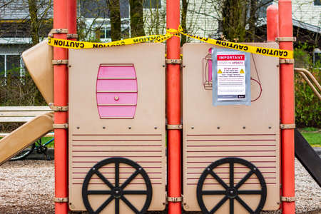 Surrey, Canada - Mar 29, 2020: Playground slide closed due to Covid-19 pandemic 新聞圖片