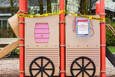 Surrey, Canada - Mar 29, 2020: Playground slide closed due to Covid-19 pandemic Editöryel