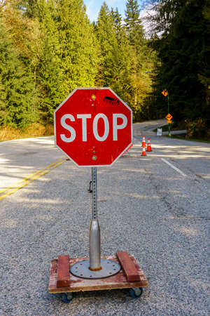 North Vancouver, Canada - Ap 7, 2020: Stop sign controls access to Mt. Seymour Provincial Park during Covid-19 pandemic Editöryel