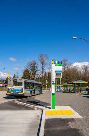 N. Vancouver, Canada - Apr 7, 2020: nearly deserted public transit bus exchange, mid-morning, during Covid-19 pandemic
