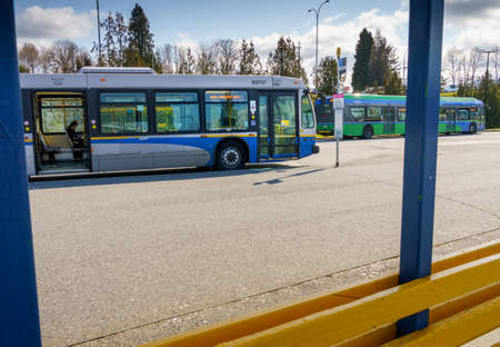 N. Vancouver, Canada - Apr 7, 2020: Public transit bus displaying message to enter rear doors during Covid-19 pandemic
