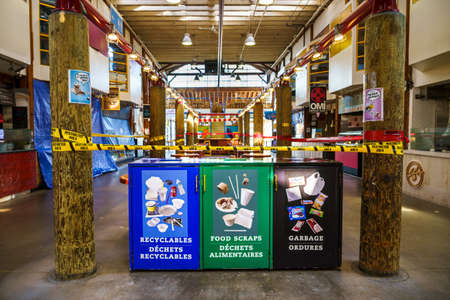 Vancouver, Canada - Apr 7, 2020: Bins and seating restrictions at Granville Island Public Market during Covid19 pandemic