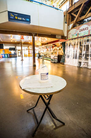 Vancouver, Canada - Apr 7, 2020: Hand sanitizer dispenser, Granville Island Public Market during Covid-19 pandemic