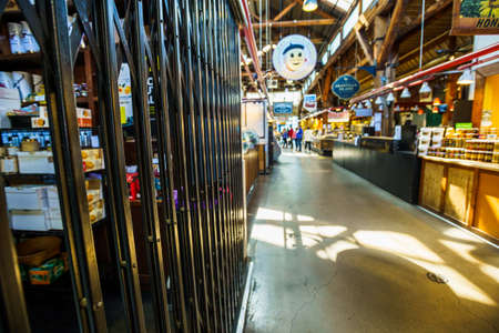 Vancouver, Canada - Apr 7, 2020: Gates across business inside Granville Island Market during Coronavirus pandemic